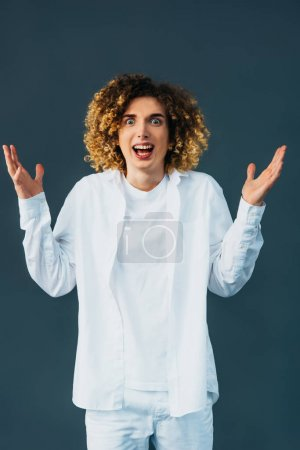 Photo for Mad stylish curly teenager in total white outfit isolated on green - Royalty Free Image