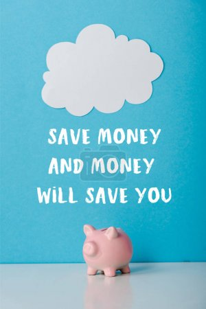 Photo pour Pink piggy bank near white cloud and save money and money will save you letters on blue - image libre de droit
