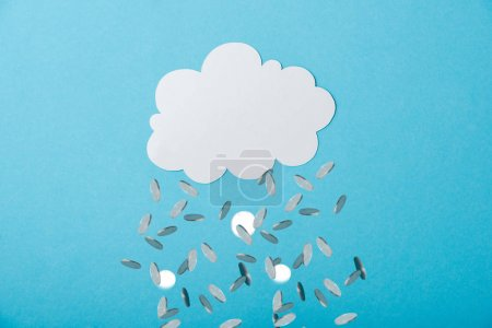 Photo for Blank white cloud near falling silver coins on blue - Royalty Free Image