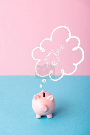 Photo for Piggy bank near thought bubble with house on pink and blue - Royalty Free Image