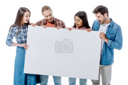 Photo for Happy multicultural friends holding blank placard isolated on white - Royalty Free Image