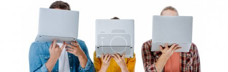 Photo for Three young friends holding laptops in front of face isolated on white, panoramic shot - Royalty Free Image