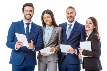 Photo for Smiling multicultural business people in suits holding digital tablets isolated on white - Royalty Free Image