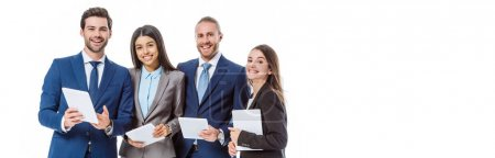 Photo for Smiling multicultural business people in suits holding digital tablets isolated on white, panoramic shot - Royalty Free Image