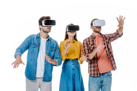 Photo for Three young friends in vr headsets gesturing isolated on white - Royalty Free Image