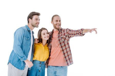 Photo for Three young friends pointing with finger away isolated on white - Royalty Free Image