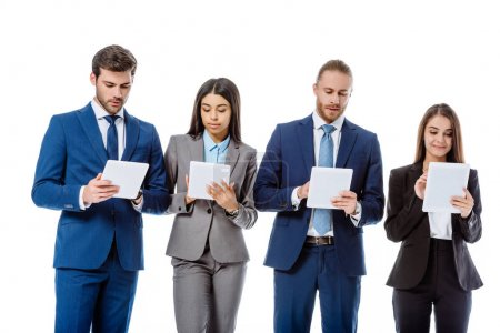 Photo for Multicultural business people in suits using digital tablets isolated on white - Royalty Free Image