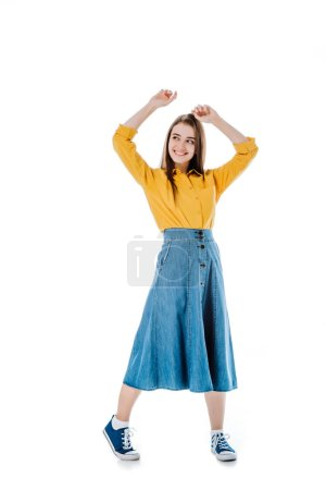 Photo for Full length view of happy attractive girl dancing with hands in air and looking away isolated on white - Royalty Free Image