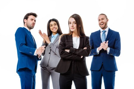 Photo for Selective focus of happy multicultural business people in suits applauding confident businesswoman in front isolated on white - Royalty Free Image