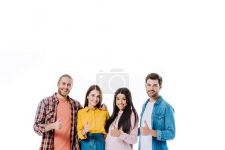 Foto de Amigos multiculturales felices mostrando pulgares aislados sobre blanco - Imagen libre de derechos