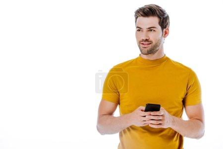 Photo pour Bel homme utilisant smartphone et regardant loin isolé sur blanc - image libre de droit