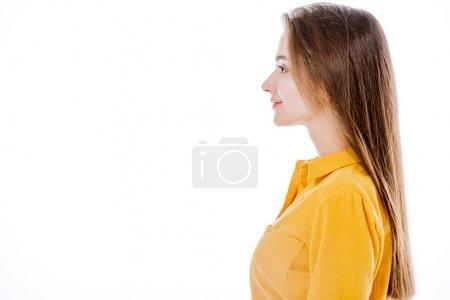 Photo pour Vue latérale de sourire jolie fille isolée sur blanc - image libre de droit