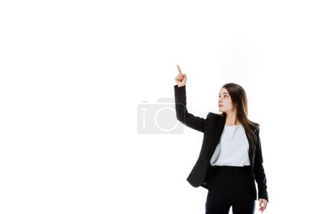 Photo for Confident businesswoman in suit pointing with finger upwards isolated on white - Royalty Free Image
