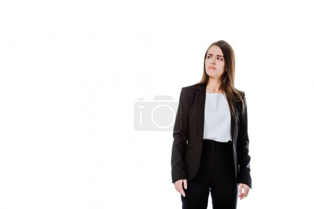 Photo for Dissatisfied businesswoman in suit looking away isolated on white - Royalty Free Image