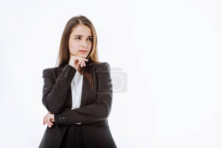 thoughtful businesswoman in suit looking away isolated on white