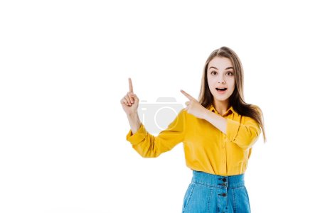 Photo for Surprised attractive girl pointing with fingers isolated on white - Royalty Free Image