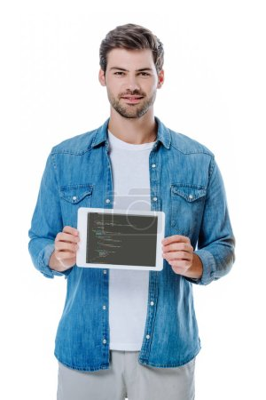 Photo for KYIV, UKRAINE - AUGUST 12, 2019: smiling man in denim shirt holding digital tablet with JavaScript page isolated on white - Royalty Free Image