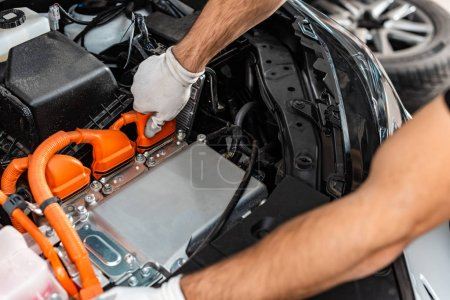 Photo for Cropped view of mechanic inspecting car engine compartment - Royalty Free Image