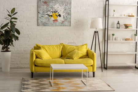 Interior with yellow sofa in living room