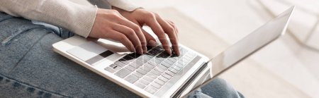 Photo for Cropped view of woman typing on laptop keyboard, panoramic shot - Royalty Free Image
