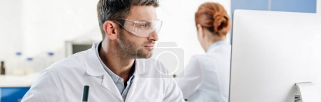 Photo for Panoramic shot of molecular nutritionist using computer in lab - Royalty Free Image