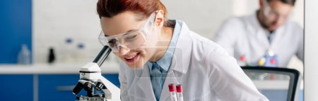 Photo for Panoramic shot of genetic consultant doing dna test in lab - Royalty Free Image