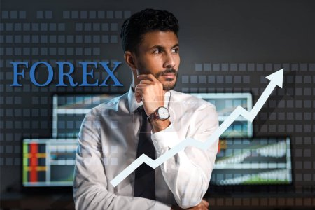 Photo pour Pensive bi-racial trader looking away near forex letters in office - image libre de droit