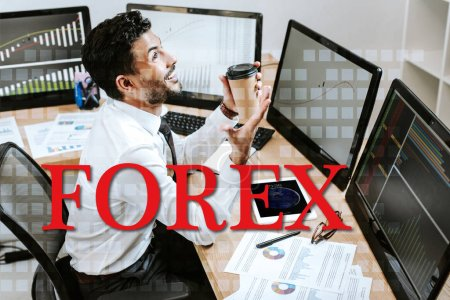 Photo pour Happy bi-racial trader holding paper cup and sitting near computers and forex letters - image libre de droit