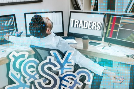 Photo for Bi-racial man with outstretched hands sitting near computers and traders letters - Royalty Free Image