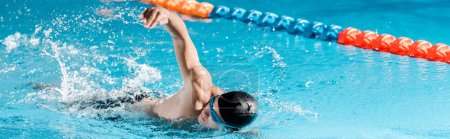 Photo for Panoramic shot of handsome swimmer training in swimming pool - Royalty Free Image