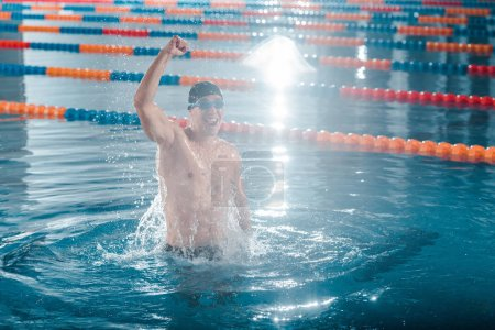 excited swimmer celebrating triumph while training in swimming pool