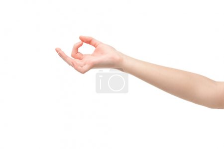 Photo pour Cropped view of woman showing ok gesture isolated on white - image libre de droit