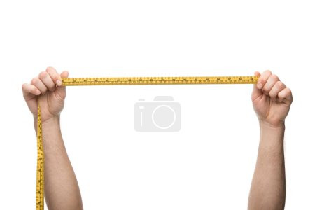 cropped view of man holding measuring tape isolated on white