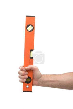 Photo for Cropped view of man holding spirit level isolated on white - Royalty Free Image