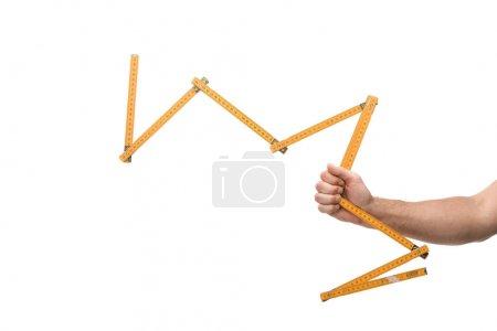 Photo pour Crochet vue d'un homme tenant un ruban à mesurer isolé sur blanc - image libre de droit