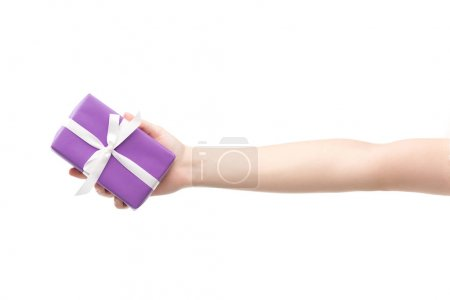 cropped view of woman holding gift isolated on white