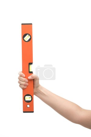Photo pour Cropped view of woman holding spirit level isolated on white - image libre de droit
