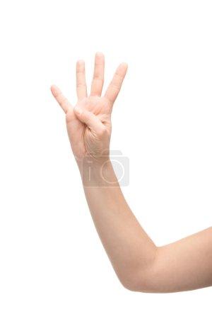 Photo pour Vue recadrée de la femme montrant quatre doigts geste isolé sur blanc - image libre de droit