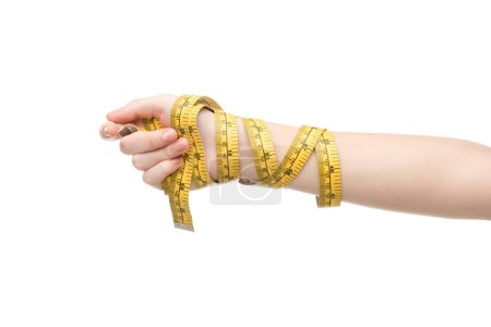 Photo for Cropped view of woman holding measuring tape isolated on white - Royalty Free Image