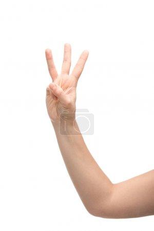 Photo pour Vue recadrée de la femme montrant trois doigts geste isolé sur blanc - image libre de droit