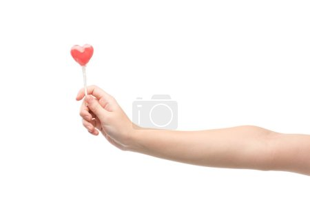 Photo for Cropped view of woman holding lollipop isolated on white - Royalty Free Image
