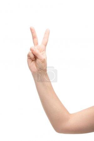 Photo pour Cropped view of woman showing peace sign isolated on white - image libre de droit