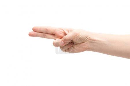 Photo pour Vue recadrée de la femme montrant deux doigts isolés sur blanc - image libre de droit