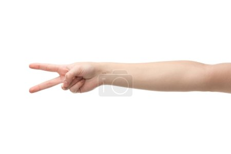 cropped view of woman showing peace gesture isolated on white