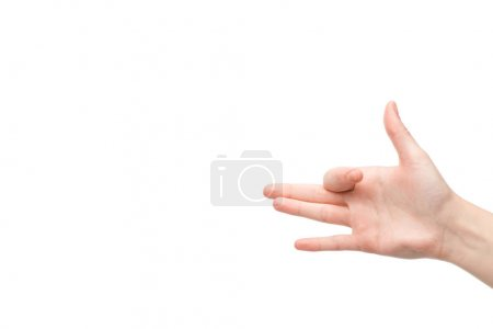 cropped view of woman showing dog head gesture isolated on white