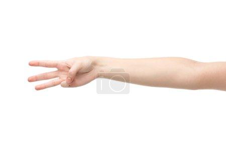 Photo pour Vue recadrée de la femme montrant trois doigts isolés sur blanc - image libre de droit