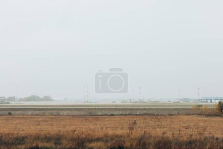 Photo for Airplanes on airfield highway with cloudy sky at background - Royalty Free Image