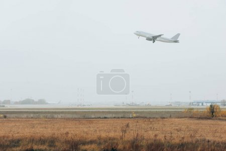Photo for Departure of commercial plane on airport runway - Royalty Free Image