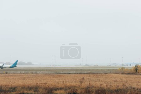 Photo for Flight departure of commercial plane on airport runway - Royalty Free Image