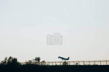 Photo pour Jet plane on airport runway at sunset - image libre de droit